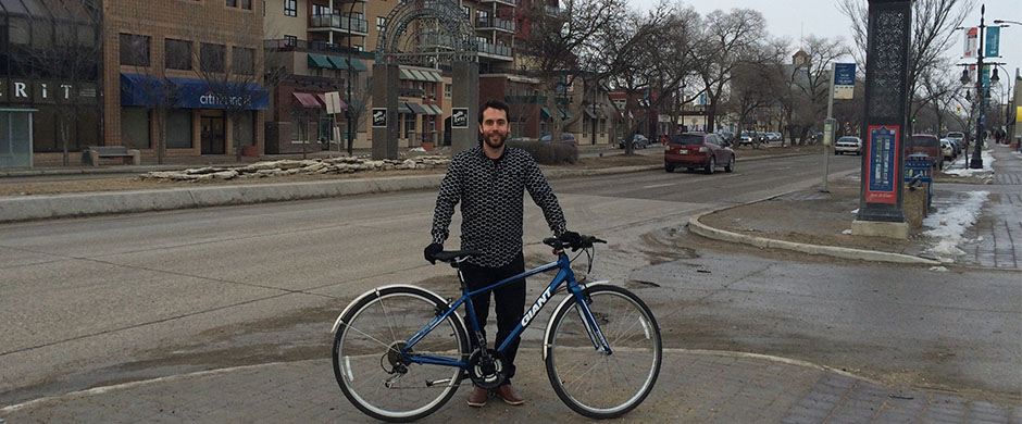Stéphane Dorge with his bike on the Provencher Boulevard